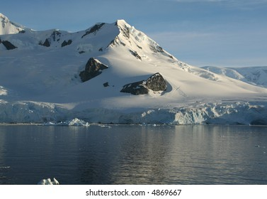 Mountains & glaciers with icefalls emptying into the ocean,,		Neko Harbor, Andvord Bay,	Antarctica