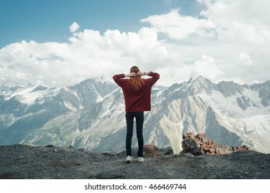 The mountains. Hikers in the mountains . Caucasus foothills,  snow-capped mountains. Happy tourists winning the goal of life , success, freedom and happiness , achievement in the mountains .