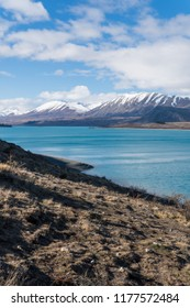 mountains and hill at Lake Tekapo while hiking on road trip