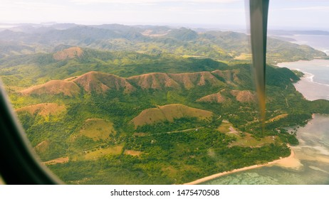 Mountains and hills of Busuanga Island as seen from aircraft on landing approach to Coron Airport - Coron, Palawan, Philippines.