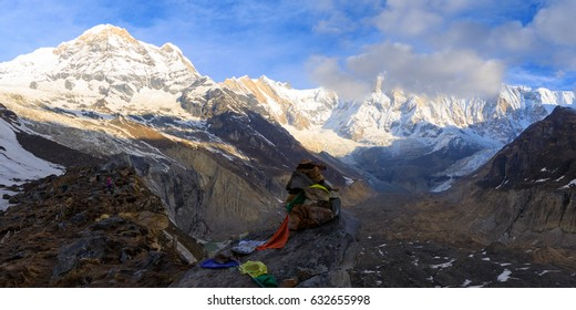 Mountains. Horizontal panorama view from Annapurna Base Camp to Mt Annapurna I on colorful sunrise with a moon on blue sky. Trekking in Himalaya, Nepal