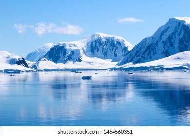 Mountains and icebergs between the islands around the Antarctic Peninsula, Palmer Archipelago, Antarctica