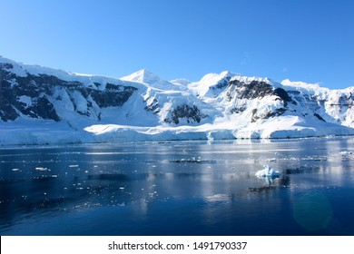 Mountains and icebergs between the islands around the Antarctic Peninsula, Palmer Archipelago, Antarctica