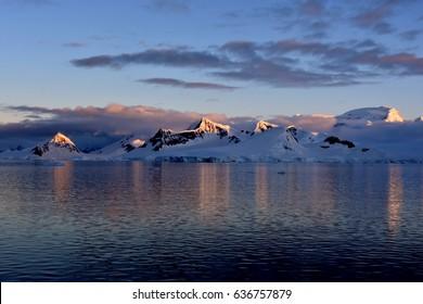 Mountains illuminated by sunset in Antarctica - Gerlache Strait