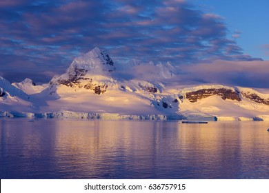Mountains illuminated by sunset in Antarctica