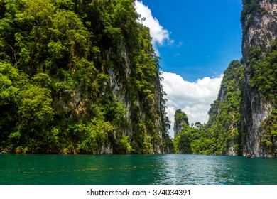 Mountains lake river sky and natural attractions in Ratchaprapha Dam at Khao Sok National Park