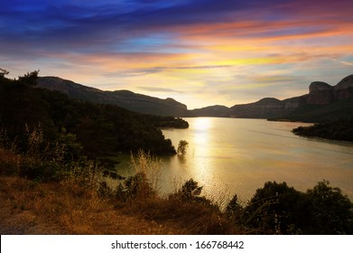 mountains lake in sunset. Sau reservoir, Catalonia