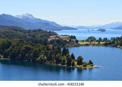 Mountains and Lakes with Building in the Green Forest