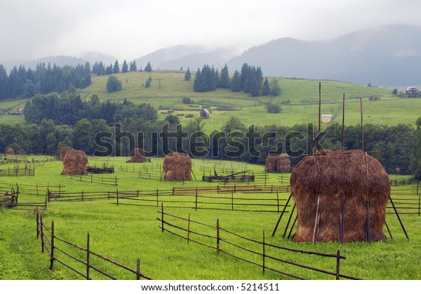 mountains landscape with haystacks