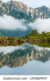 Mountains landscape with reflection in Hakuba Happo-one Japan