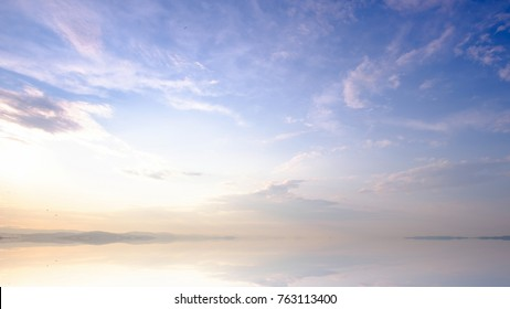 Mountains landscape at sunrise - cloudy sky in pastel colors for your design