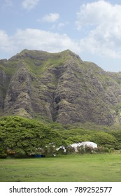 Mountains and Lush Forest Against Blue Sky in Hawaii
