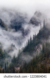 Mountains in the mist. Jiuzhaigou Valley was recognize by UNESCO as a World Heritage Site and a World Biosphere Reserve - SiChuan, China