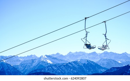 mountains with modern ski lift chairs