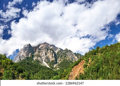 Mountains near San Candido village at daylight. White clouds on sky. Italy beauties