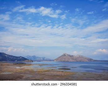 Mountains on the sky background with clouds