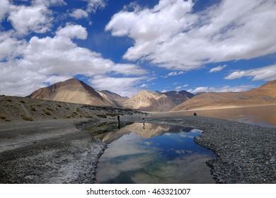 Mountains and Pangong lake with blue sky.