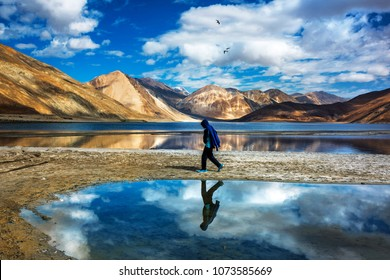 Mountains and Pangong tso (Lake). It is huge and highest lake in Ladakh and blue sky in background, it extends from India to Tibet. Leh, Ladakh, Jammu and Kashmir, India