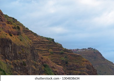 Mountains peak against cloudy sky in Calheta on Portuguese island of Madeira