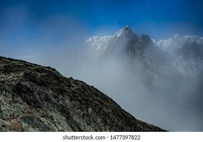 Mountains peaks with beautiful sky. Cloudy weather. High Tatry. Slovakia.