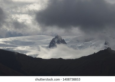 Mountains peaks and glacier in heavy clouds in National Park Skaftafell in South Iceland