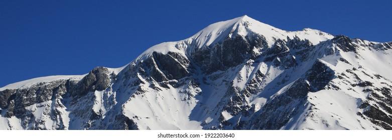 Mountains Piz Segnas and Piz Sardona in winter. View from Elm.