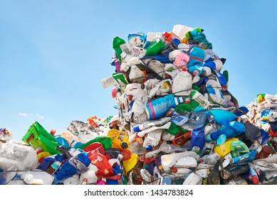 Mountains of plastic rubbish outdoors at recycling factory near the dump