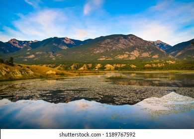 Mountains reflected in the Columbia Wetlands in Fall or Autumn, near Invermere, British Columbia, Canada