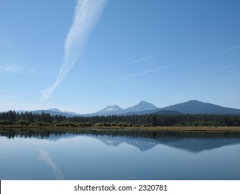 Mountains reflected in Phalarope Lake at Oregon's Black Butte Ranch
