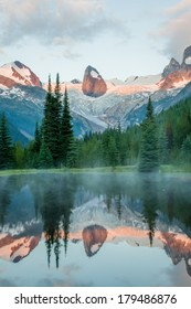 mountains reflected in a pond in a vertical image