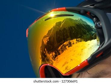 Mountains reflected in a ski mask illuminated solar flare