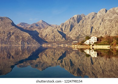 Mountains reflected in the water, winter Mediterranean landscape. Montenegro, Adriatic Sea, Bay of Kotor, Dobrota