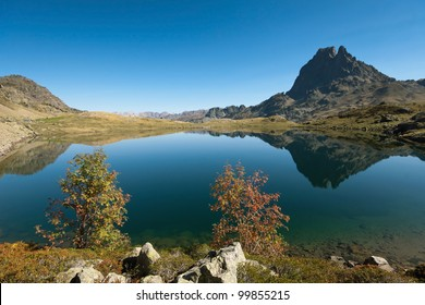 Mountains reflecting in a beautiful lake. Lac Roumassot (Lacs d'Ayous) with Pic du Midi d'Ossau 2884 m, Parc national des Pyrenees, Aquitaine, France.