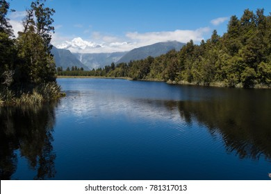 Mountains reflecting in Lae Matheson