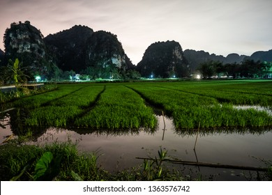 Mountains and rice fields of northern Vietnam at night.