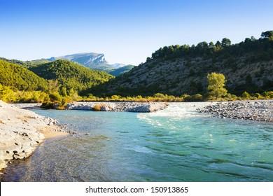 Mountains river with rocky riverside. Cinqueta, Huesca, Aragon