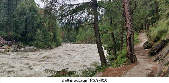 Mountains river trees and a path leading to Kasol village located in Himachal Pradesh India