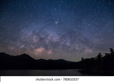 Mountains, rivers, stars and the Milky Way in the night sky of a very beautiful new day.