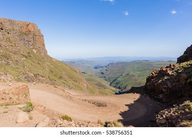 Mountains Road Pass Mountains steep dirt road sani-pass rugged route through scenic rural valley landscape..