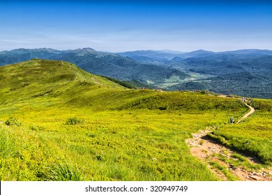 Mountains scenery. Panorama of grassland and forest in Bieszczady National Park. Carpathian mountains landscape, Poland. Bieszczady are part of Beskid mountains which a part of Catpathian mountains.