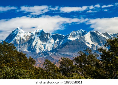 Mountains in the snow. Landscape with clouds. Scenic view of Himalayan ranges. Landscape with trees and sky, clouds and mountains. Scenic mystic view of Himalaya on trek, Bramhatal, Lohjung