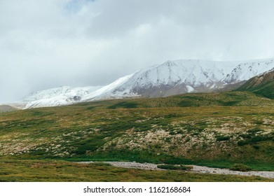 The mountains with snowy peaks