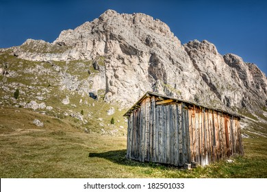 Mountains in South Tirol, wooden cottage