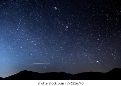 Mountains, stars, zodiacal light and the Milky Way on a beautiful night sky.