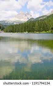 Mountains surround Lake Misurina in the Dolomite Alps near Toblach, Italy