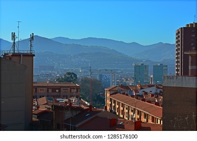 Mountains surrounding buildings
