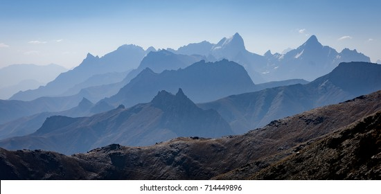 Mountains of Tajikistan in the distance turned blue from hazy afternoon and long distance