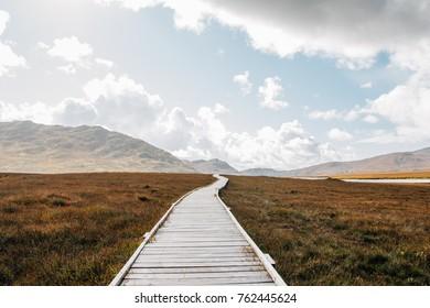 mountains trail road sun clouds grass