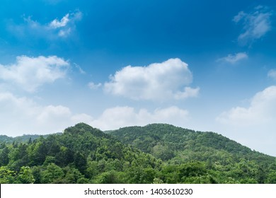 Mountains and tree with beautiful blue sky and cloud in the morning