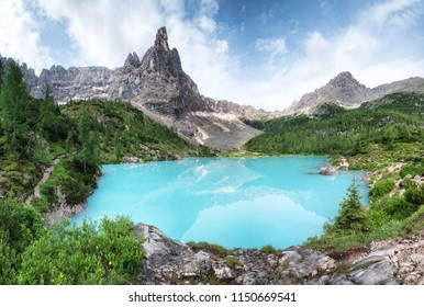 Mountains and turquoise lake in the Dolomites apls, Italy. Sorapis lake in the Italy. Beautiful landscape at the summer time